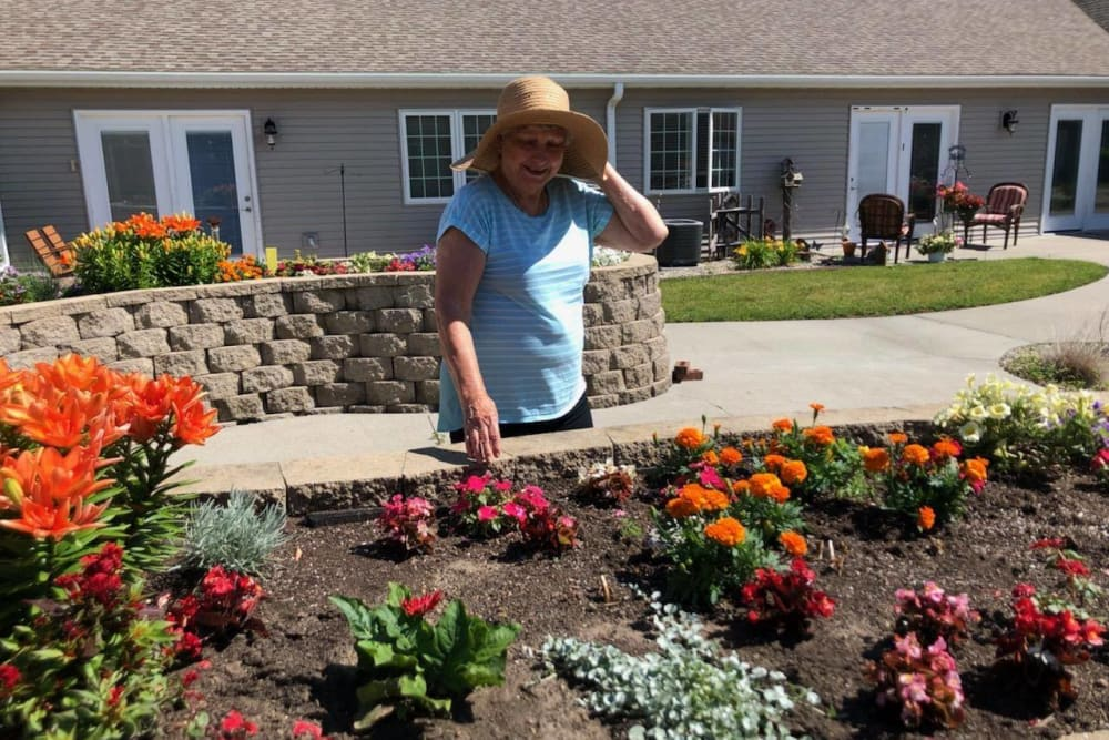A resident gardening at Villas of Holly Brook Newton in Newton, Illinois