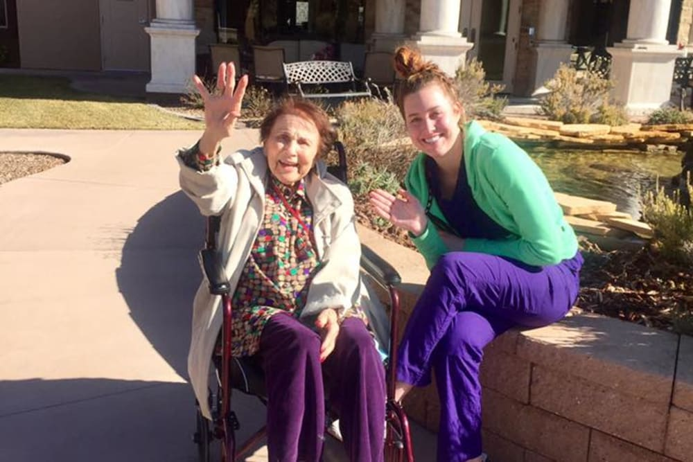 A resident and a staff member waving hello at The Retreat at Sunbrook in St. George, Utah