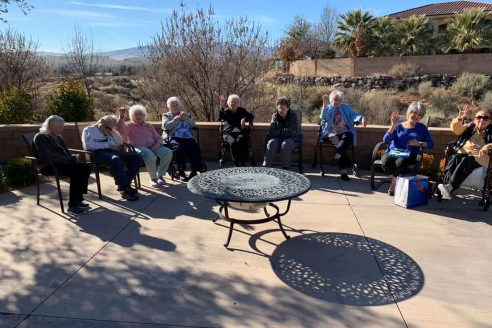 A group of residents outside in the sunshine at The Retreat at Sunbrook in St. George, Utah