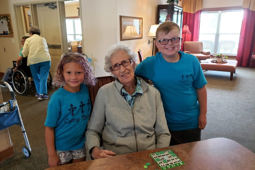 Children visiting a resident at Landings of Oregon in Oregon, Ohio
