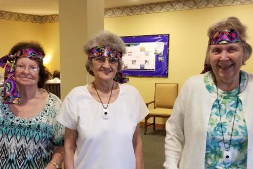 Residents with 60's accessories on at Landings of Sidney in Sidney, Ohio