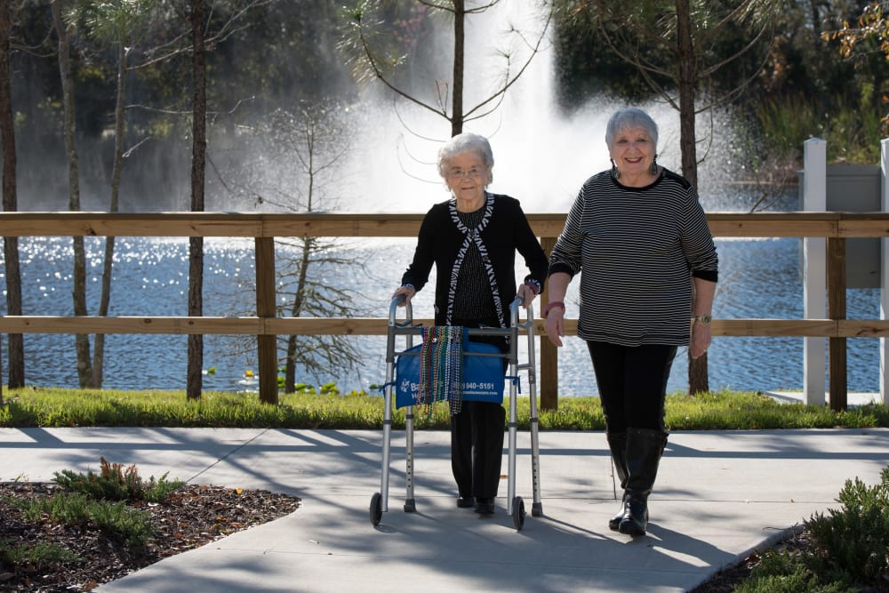 Residents out for a walk near Inspired Living at Lakewood Ranch in Bradenton, Florida.