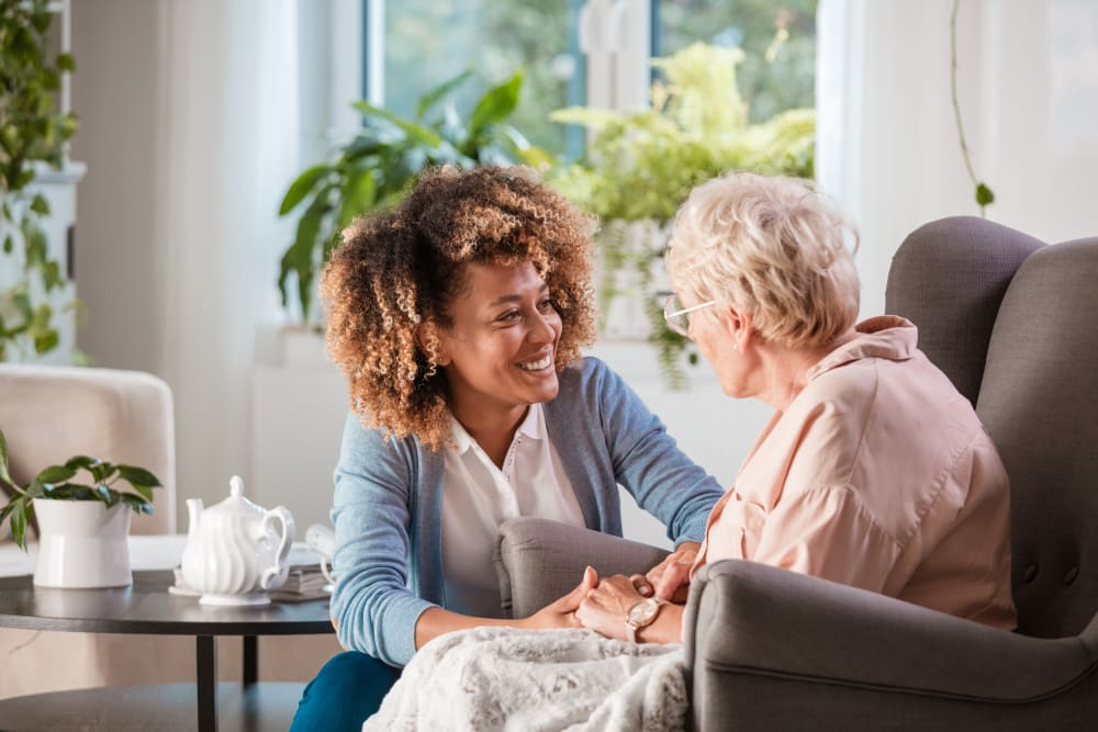 staff member comforting a resident at Alura By Inspired Living in Rockledge, Florida.