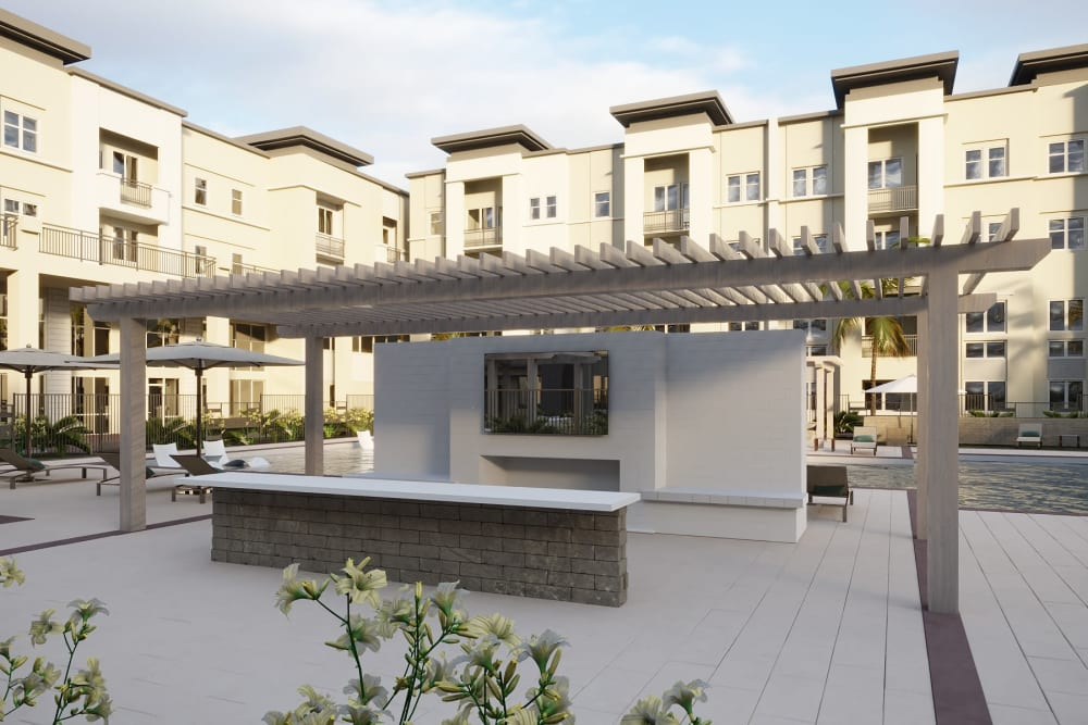 Outdoor community space by pool at The District at Chandler in Chandler, Arizona