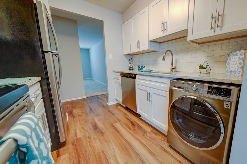 Kitchen with hardwood flooring at Beacon Pointe Apartments & Townhomes in Sparrows Point, Maryland