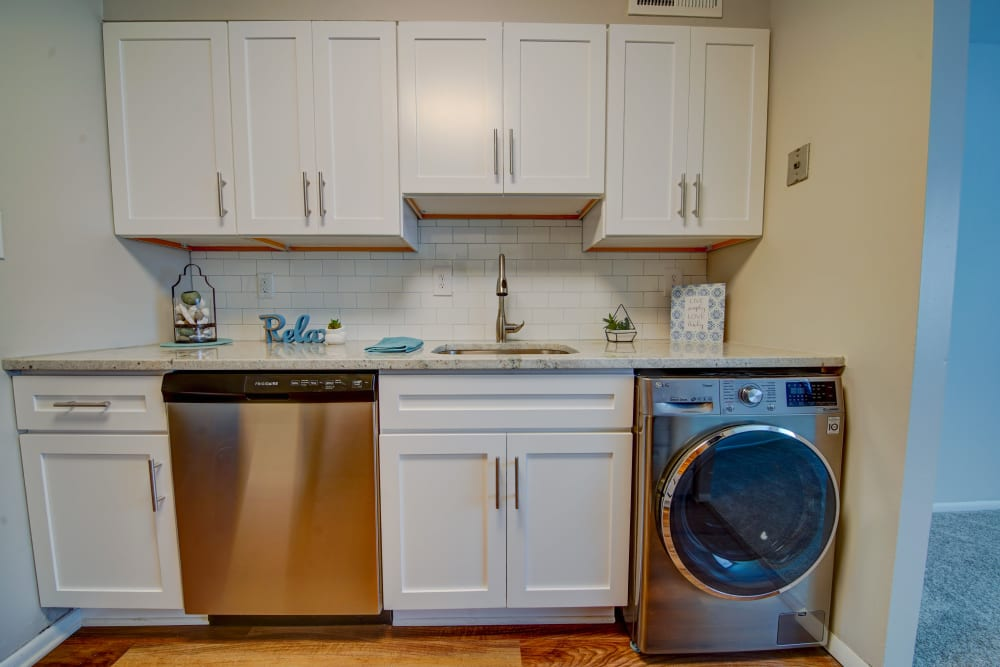 Kitchen with stainless steel appliances at Beacon Pointe Apartments & Townhomes in Sparrows Point, Maryland