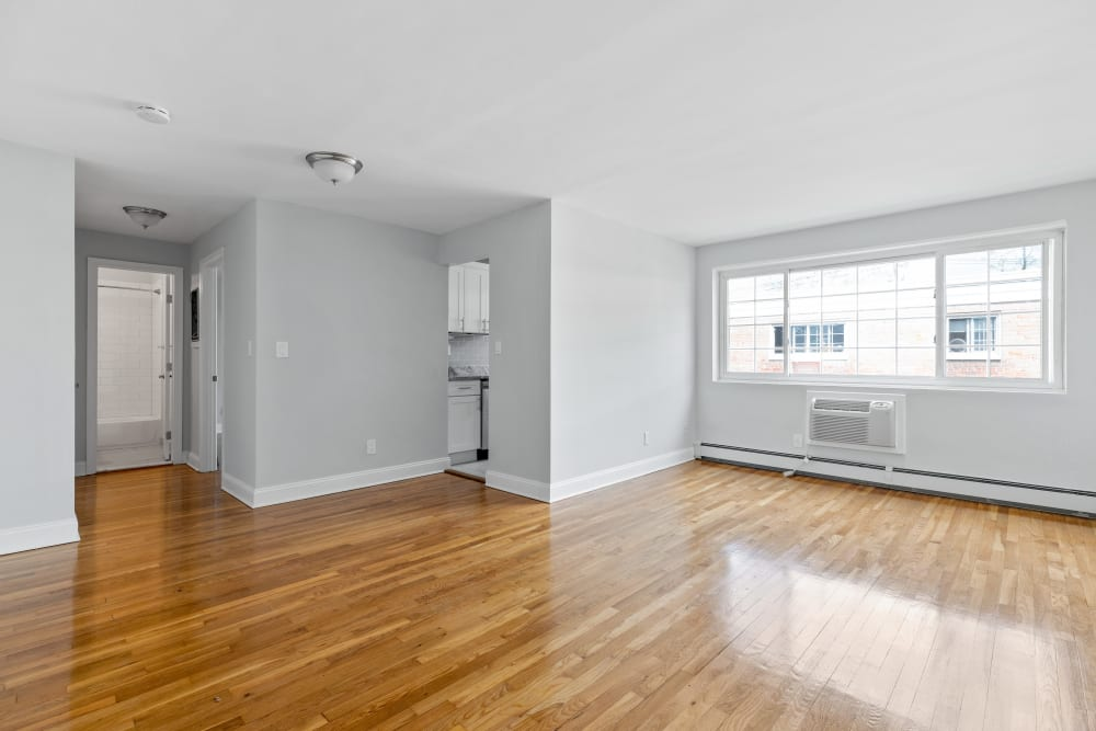 Spacious living area at Eagle Rock Apartments at Carle Place in Carle Place, New York