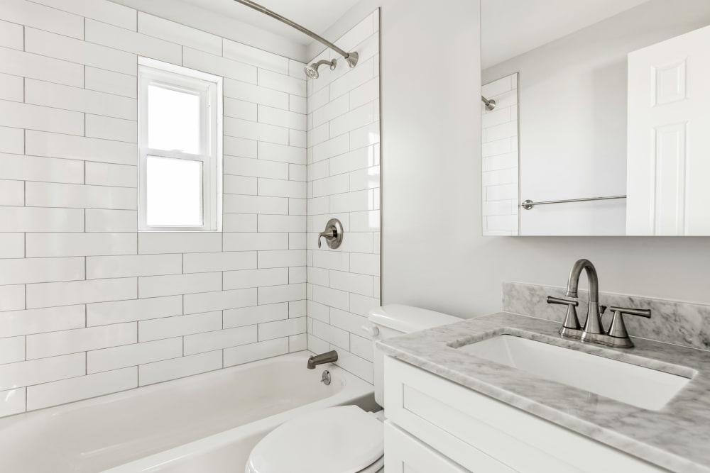 Clean, bright bathroom at Eagle Rock Apartments at Huntington Station in Huntington Station, New York