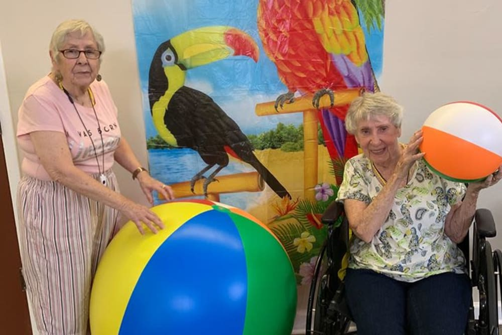 Residents with beach balls at Forest Oaks of Spring Hill in Spring Hill, Florida