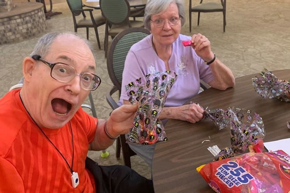 Residents making candy bags to pass out on Halloween at Forest Oaks of Spring Hill in Spring Hill, Florida