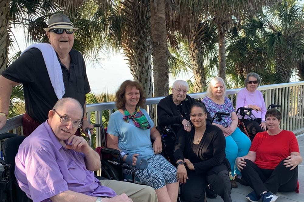 Residents enjoying the sunshine at Forest Oaks of Spring Hill in Spring Hill, Florida