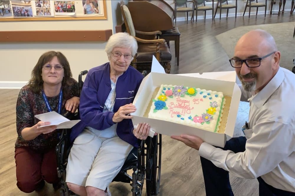 A resident receiving a cake for her birthday at Forest Oaks of Spring Hill in Spring Hill, Florida