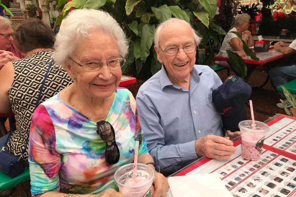 A happy couple enjoying smoothies at Lake Morton Plaza in Lakeland, Florida