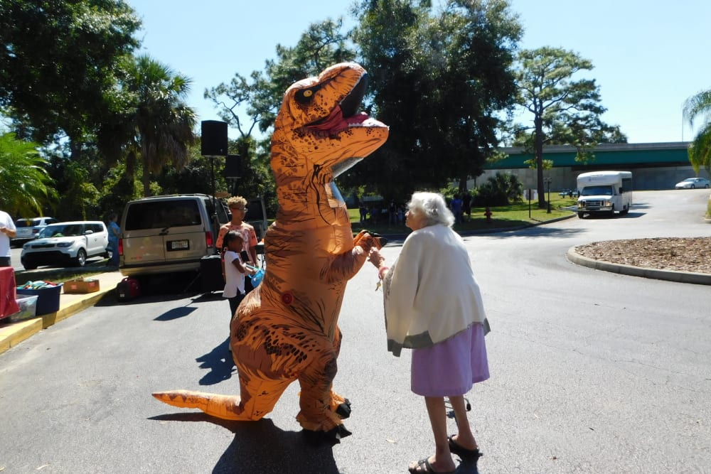A resident and a dinosaur at Renaissance Retirement Center in Sanford, Florida