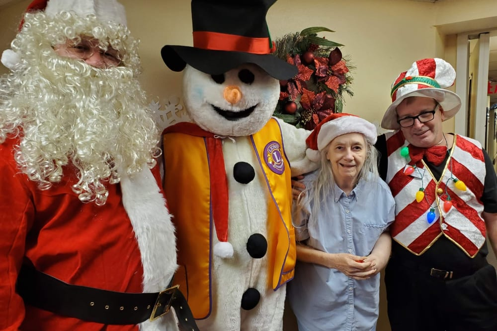 Residents with Santa and a snowman at Spring Haven in Winter Haven, Florida