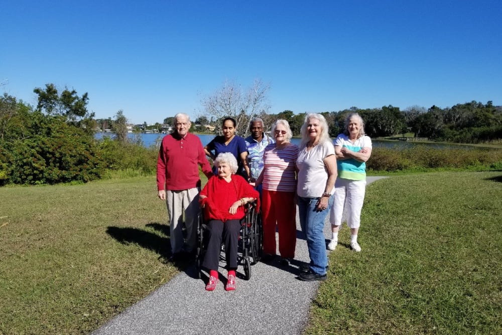 Residents outside near the water at Spring Haven in Winter Haven, Florida
