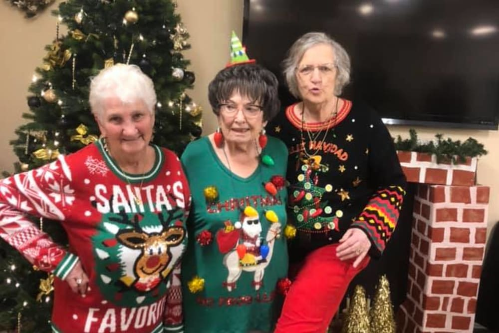 Residents with ugly Christmas sweaters on at The Grande in Brooksville, Florida