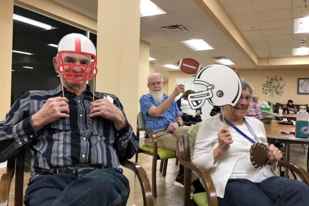 Residents enjoying a football game at The Grande in Brooksville, Florida