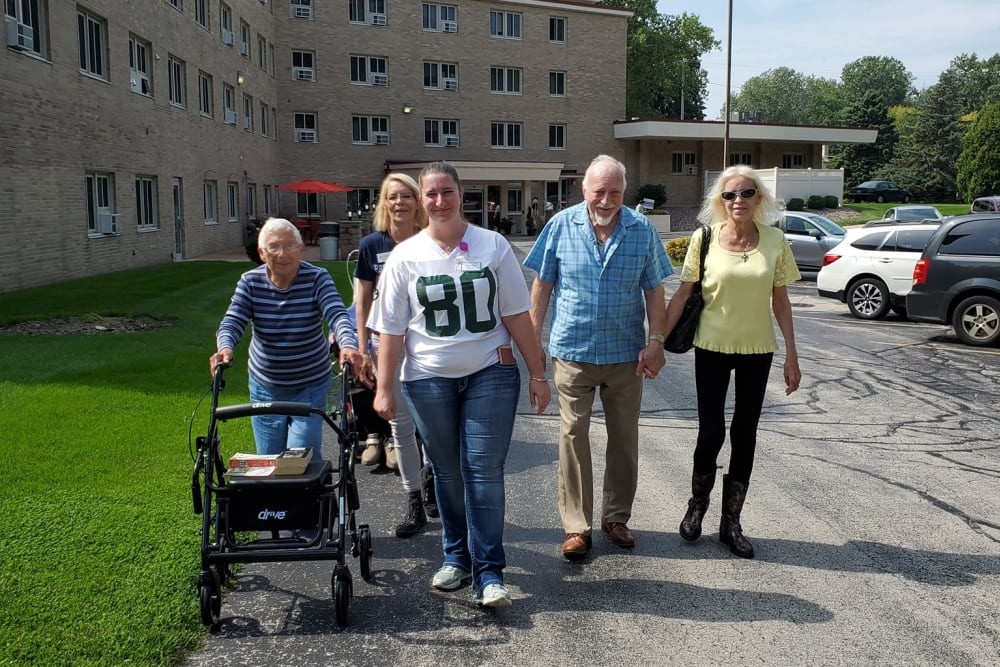 Residents out for a walk at The Woods of Caledonia in Racine, Wisconsin