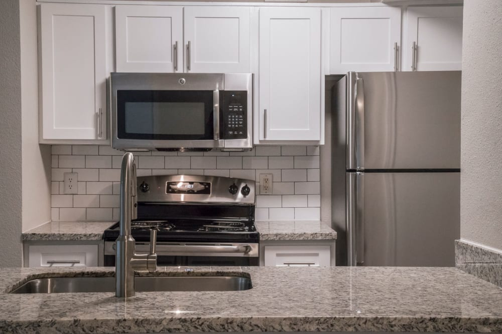 Kitchen stainless steel appliances at IMT At The Medical Center in Houston, Texas