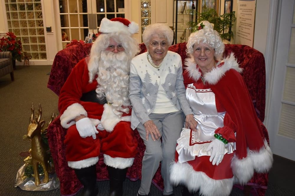 A resident with Santa and Mrs. Claus at Eastlake Terrace in Elkhart, Indiana