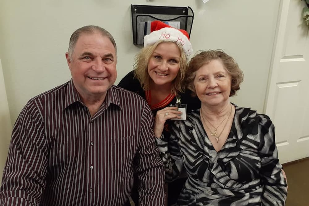 Happy residents and family at Cedar Crest Memory Care in Lafayette, Louisiana