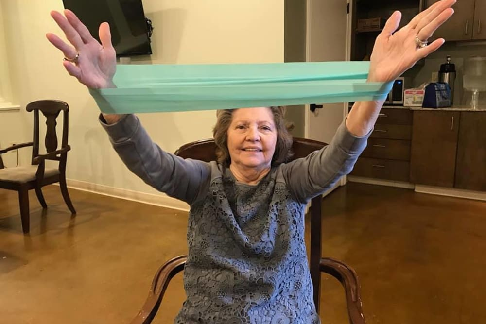 A resident stretching at Cedar Crest Memory Care in Lafayette, Louisiana