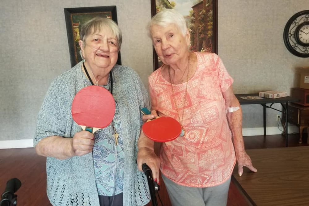 Residents playing ping pong at Legacy Oaks of Sacramento in Sacramento, California