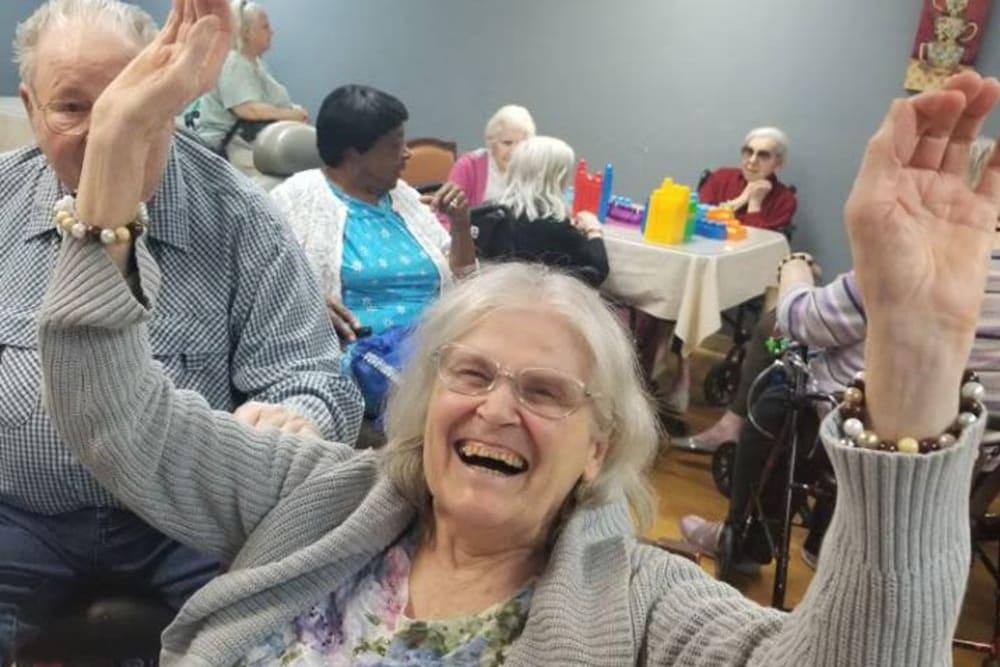A very happy resident at Legacy Oaks of Sacramento in Sacramento, California
