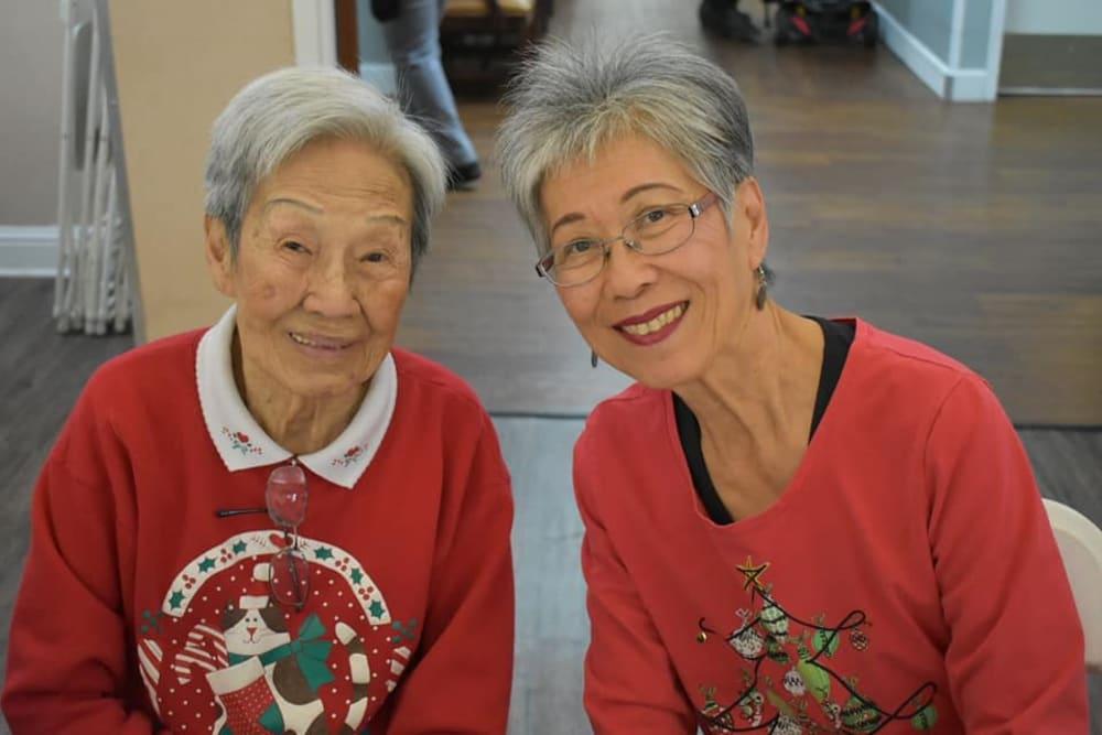 Two smiling residents at Legacy Oaks of Sacramento in Sacramento, California