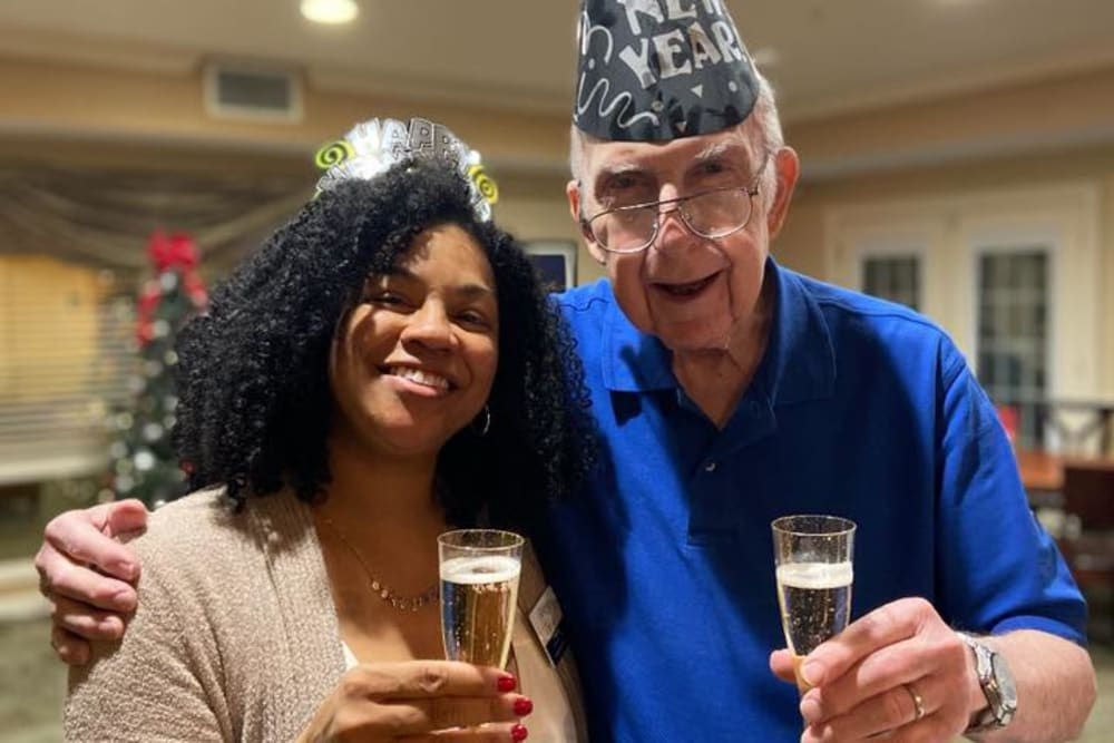 A resident and a caregiver celebrating at The Crossings at Bon Air in Richmond, Virginia