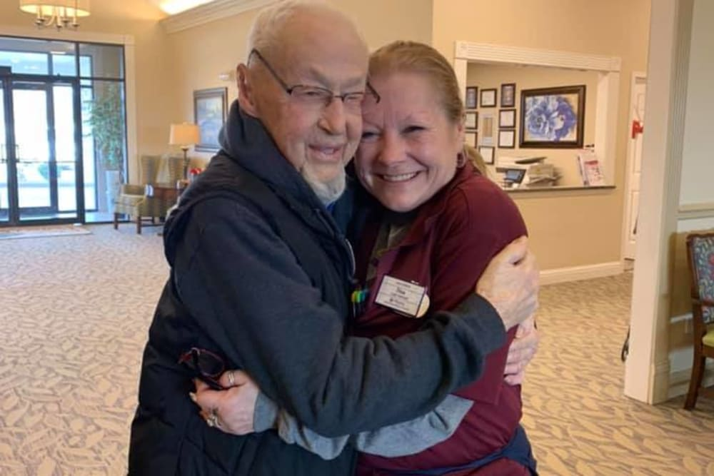 Residents hugging at Oak Pointe of Warrenton in Warrenton, Missouri