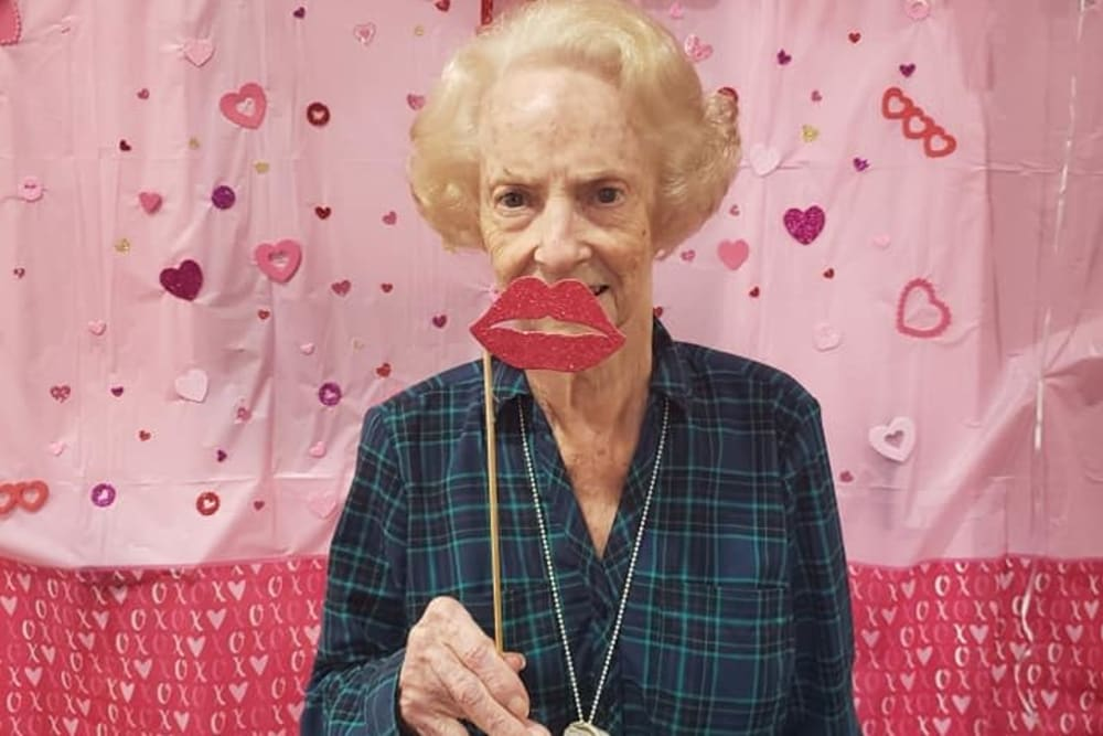 A resident celebrating Valentine's Day at Pelican Bay in Beaumont, Texas