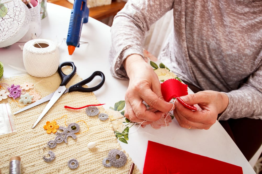 A resident doing crafts at a Randall Residence community