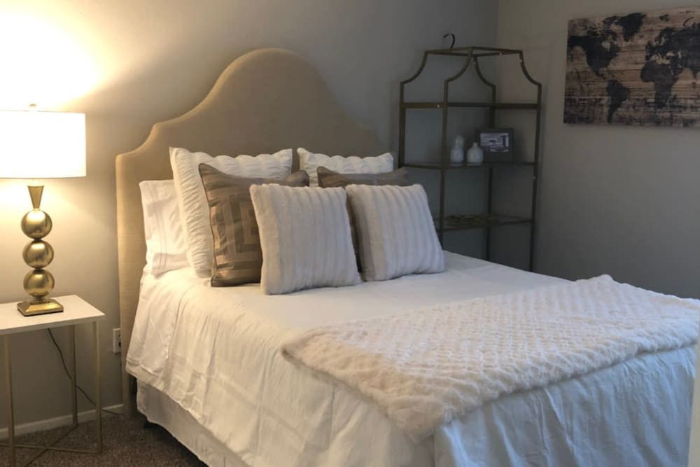 Bed and nightstand at Presidio Apartments in Allen, Texas