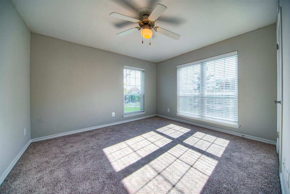 Bedroom with a ceiling fan at Hampton Point Apartment Homesin Silver Spring, Maryland