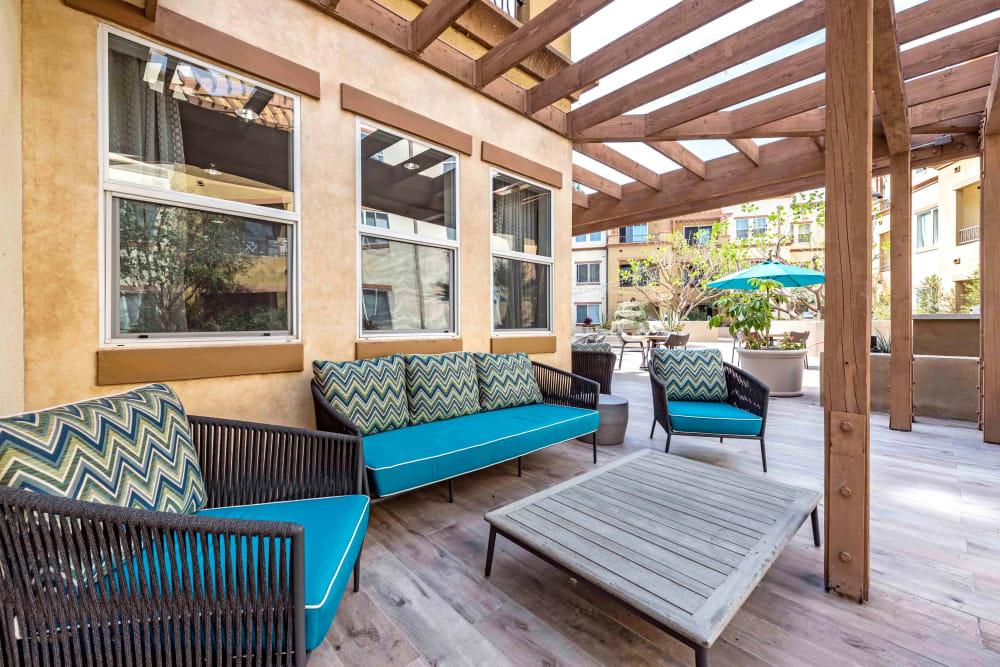 Outside lounge with a pergola overhead at Sofi at Topanga Canyon in Chatsworth, California