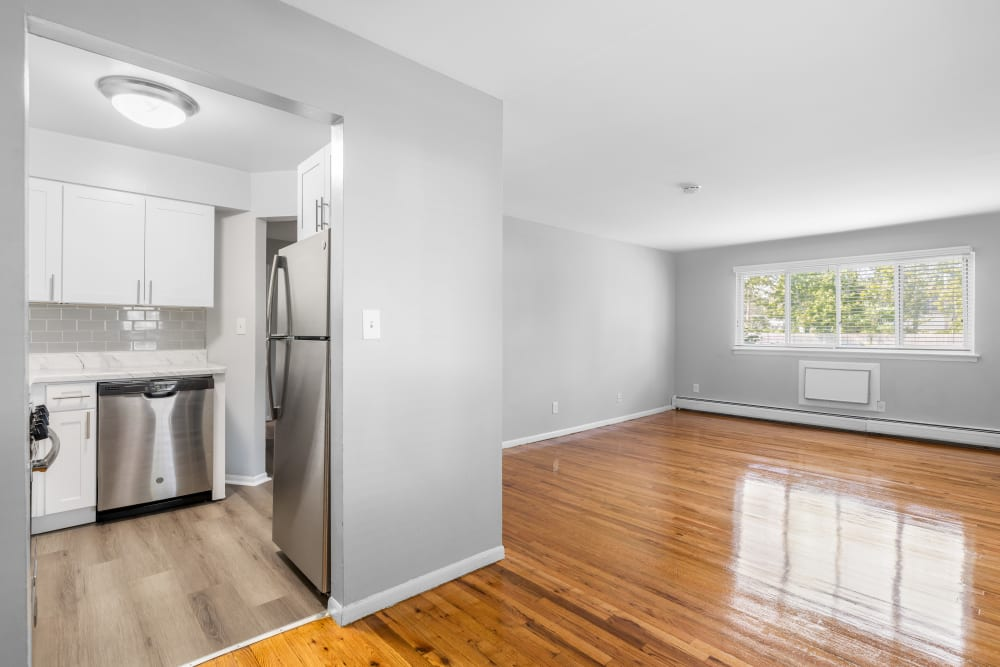 Modern finishes include stainless steel appliances and polished hardwood floors at Mid Island Apartments in Bay Shore, New York
