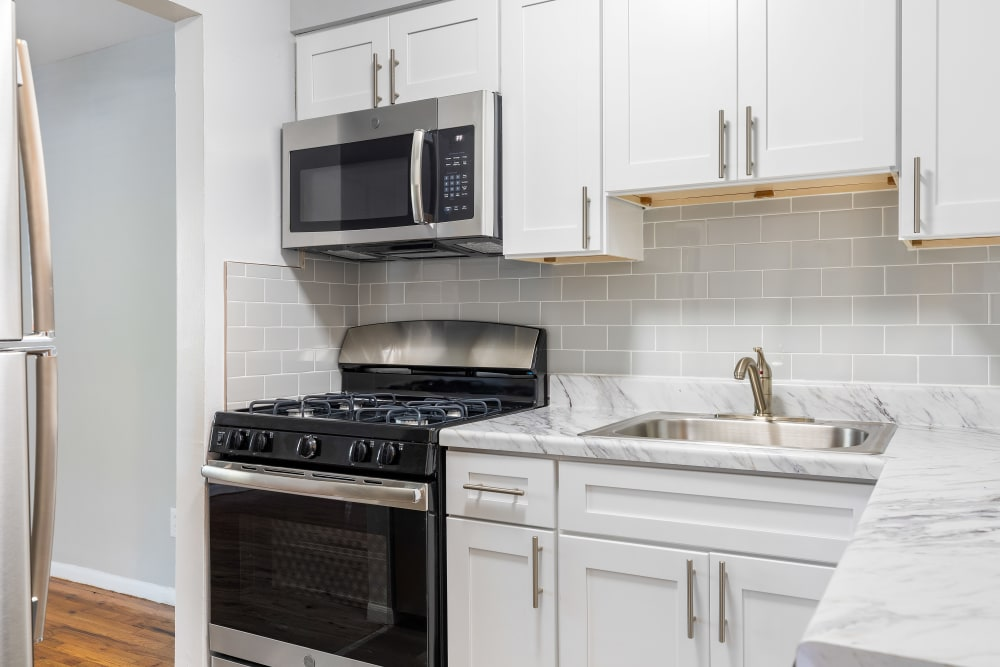 Bright white kitchens at Mid Island Apartments in Bay Shore, New York