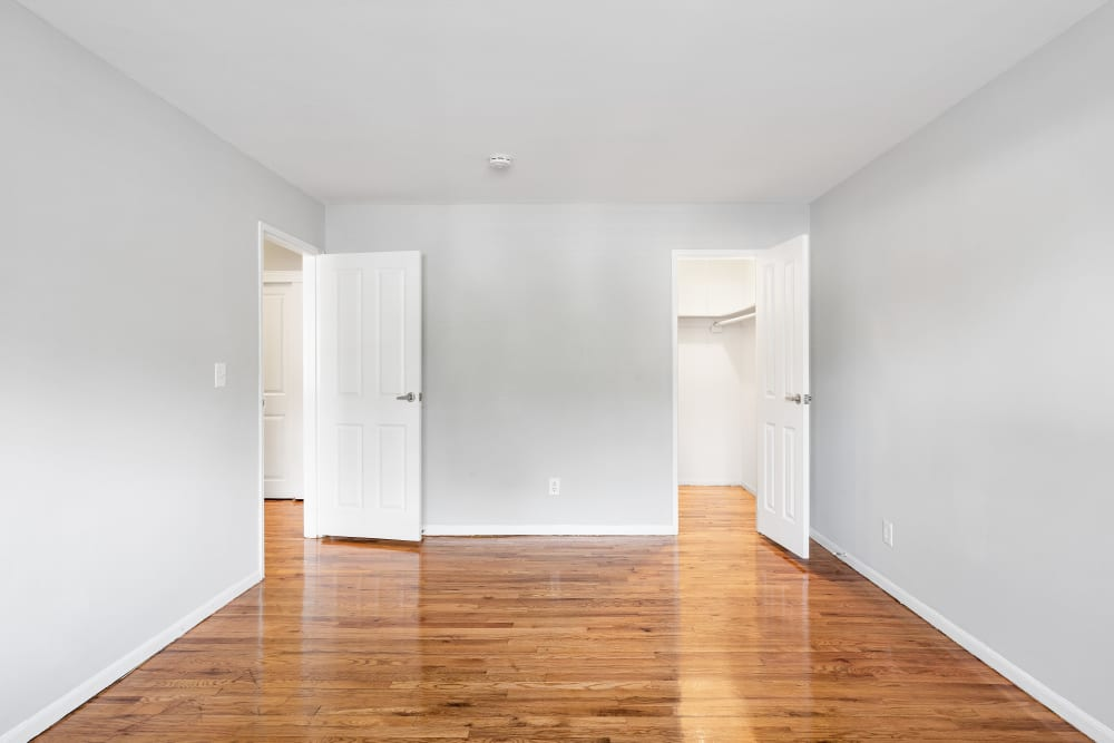Spacious bedrooms with walk-in closets in some units at Mid Island Apartments in Bay Shore, New York