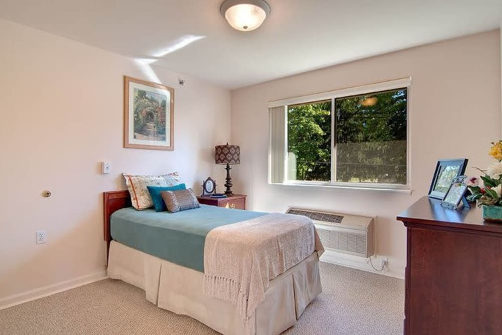 Model bedroom with twin bed at Brentwood at Niles in Niles, Michigan
