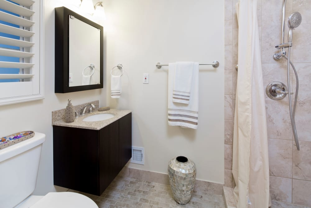 Resident Bathroom with walk in shower at Meridian at Bella Mar
