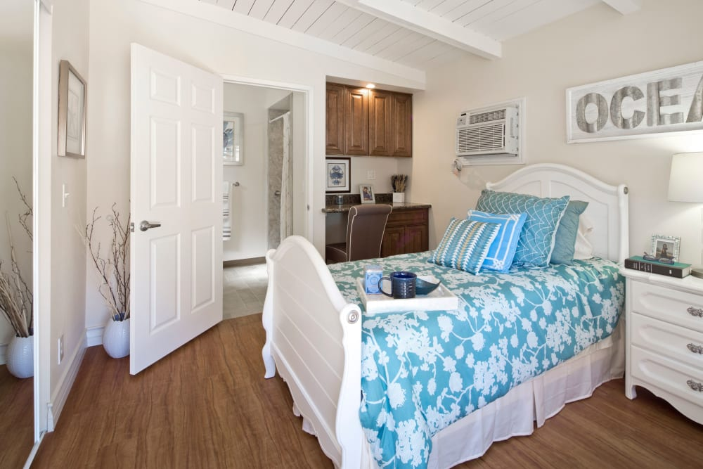 Model bedroom with queen size bed at The Meridian At Bella Mar