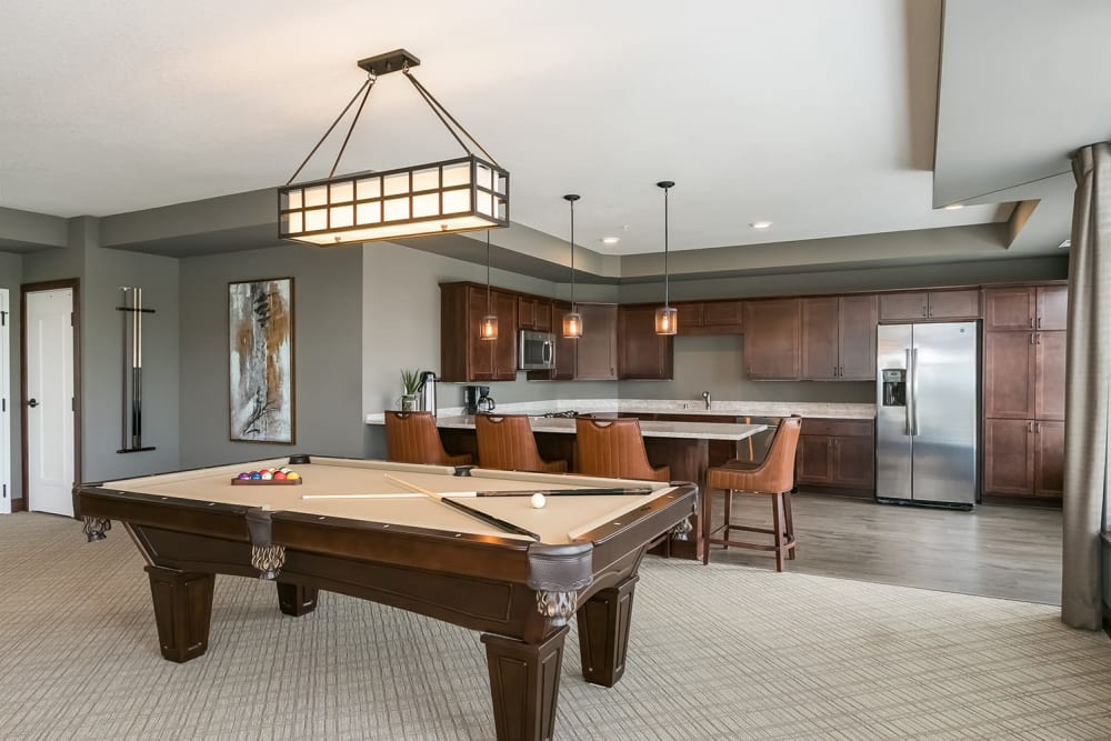 Resident club room at Applewood Pointe of Champlin at Mississippi Crossings in Champlin, Minnesota.