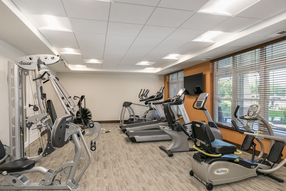 Fitness center with cardio machines at Applewood Pointe of Champlin at Mississippi Crossings in Champlin, Minnesota.