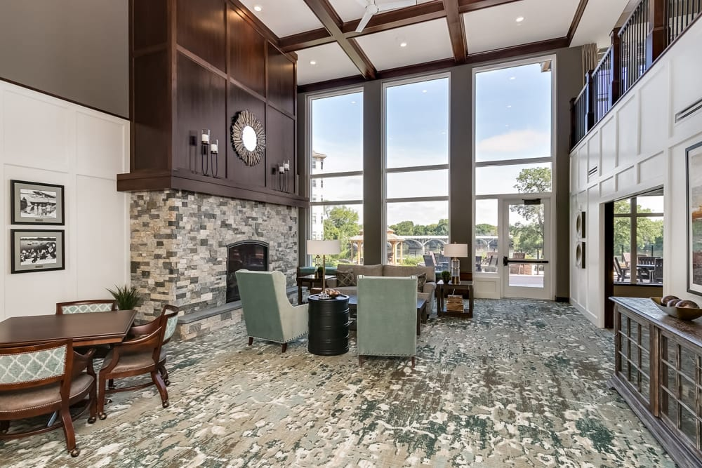 Lobby seating area at Applewood Pointe of Champlin at Mississippi Crossings in Champlin, Minnesota.