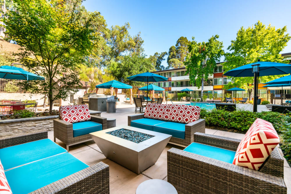 Beautiful outdoor lounge area with a fire pit at Sofi Belmont Glen in Belmont, California