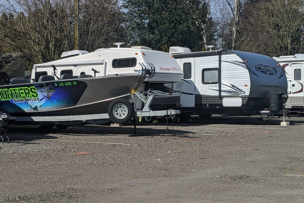 A boat and RVs stored at I-205 Mini Storage in Vancouver, Washington