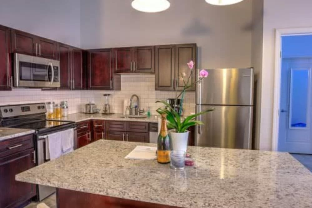 Kitchen with granite counters at Steelyard in St. Louis, Missouri
