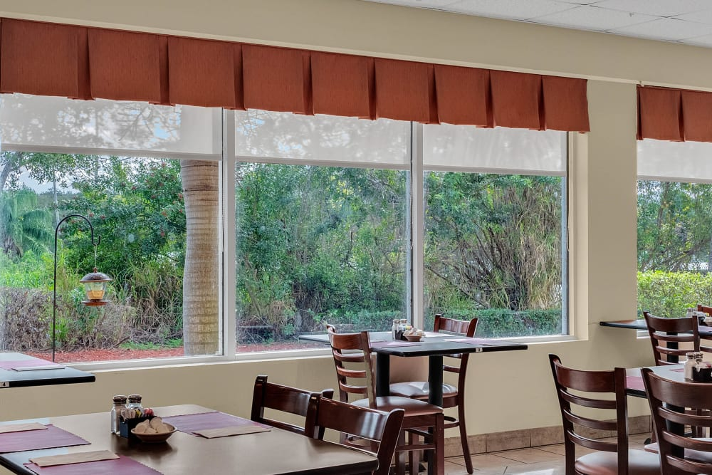 Seating area with beautiful outside views at {location_name}} in Lake Placid, Florida